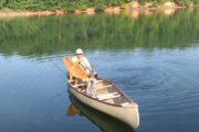 Dogs fishing in canoe