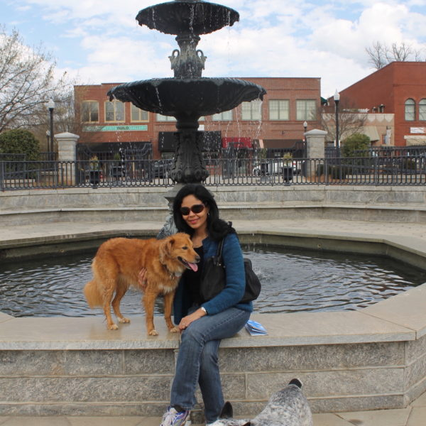 Claudia with her dogs at a fountain in Yadkin Valley