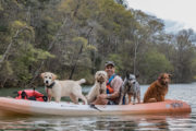 David Blank kayaking with his dogs