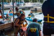 Dogs and their humans getting ready to go kayaking